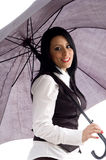 Caucasian model smiling and holding an umbrella. Portrait of caucasian model smiling and holding an umbrella against white background stock image