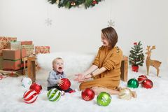 Caucasian mother with baby boy celebrating Christmas or New Year stock photos