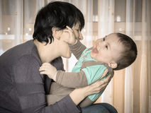 Caucasian mother and her baby playing together at home Royalty Free Stock Photos