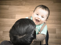 Caucasian mother and her baby playing together at home Royalty Free Stock Image