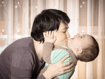Caucasian mother and her baby playing together at home Stock Photography