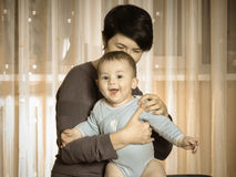 Caucasian mother and her baby playing together at home Stock Image