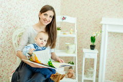 Caucasian mother and her child Stock Photos