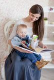 Caucasian mother and her child read a book Royalty Free Stock Photos