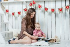Caucasian mother and her child read a book Stock Images