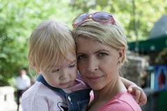Caucasian mother is holding and embracing her little girl Royalty Free Stock Photo
