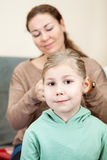 Caucasian mother making braids to her daughter Royalty Free Stock Image