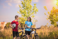 Caucasian Mountain Bikers Walking with Bikes  in Forest Environm Royalty Free Stock Photo