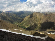 The Caucasian mountains. Rocky mountains, cumulus and its shadow on the slopes Stock Images