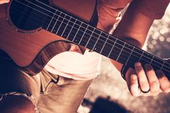 Musician with Acoustic Guitar. Caucasian Musician with Acoustic Guitar. Closeup Photo. Guitar Player Stock Images