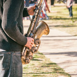 Caucasian musician entertaining people for money in park. Royalty Free Stock Photos