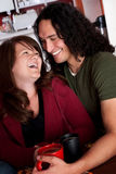 Caucasian and Native American Couple. Embracing at a cafe royalty free stock photo