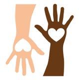 Caucasian och svarta händer Arkivfoton