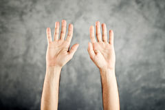 Caucasian Open hands raised for surrender Stock Photo
