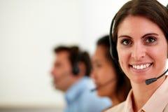 Caucasian operator woman smiling at you Stock Photos