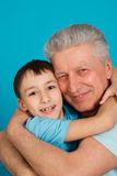 Caucasian pensioner man with a boy Stock Photo