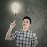 Caucasian person pointing at lamp Stock Photo