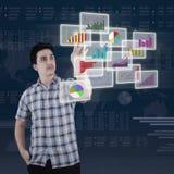 Caucasian person using futuristic interface Stock Photo