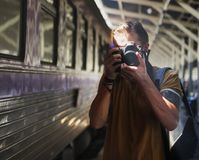 Caucasian photographer at the train station Stock Images