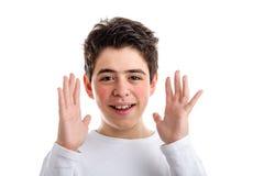 Caucasian pojke med akne-benägen hud som vinkar öppna händer längs set Royaltyfri Fotografi