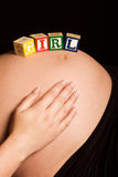 Caucasian pregnant woman with wooden blocks Stock Photography