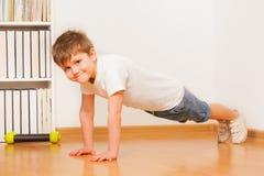 Caucasian preschooler boy making gymnastics Royalty Free Stock Images