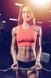 Caucasian pretty fitness girl on diet training pumping up muscle stock photography