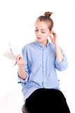 Caucasian pretty girl holding pad with pen thinking about writin Stock Photography
