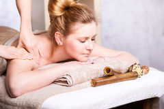 Caucasian pretty  woman having body massage. Caucasian pretty  women having body massage Stock Photography