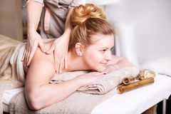 Caucasian pretty  woman having body massage. Caucasian pretty  women having body massage Stock Image