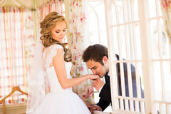 Caucasian prime adult male groom kissing hand of female bride Stock Photo