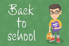 Caucasian pupil with backpack and textbook. Caucasian pupil with backpack and tutorial. Smiling happy pupil in glasses holding textbook and with backpack in Royalty Free Stock Image