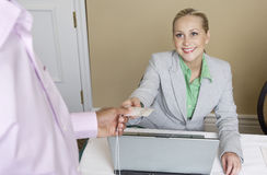 Caucasian Receptionist Handing Out Name Tag Stock Photos