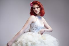 Caucasian Red-Haired Female In Tailored Wedding Dress. Stock Photos