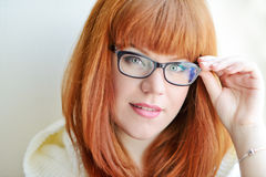 Caucasian redhead girl with glasses Royalty Free Stock Photos