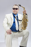Caucasian Saxophone Player Posing with Instrument In Sunglasses Royalty Free Stock Photo