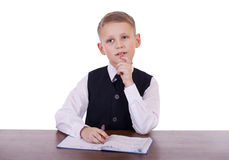 Caucasian school boy at his desk on white background with copy s Royalty Free Stock Photo