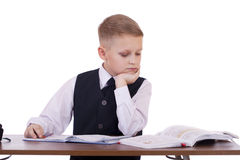 Caucasian school boy at his desk on white background with copy s Royalty Free Stock Photos