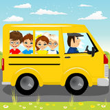 Caucasian school kids riding a schoolbus Stock Photos