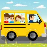 Caucasian school kids riding a schoolbus Stock Photos