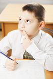 Caucasian schoolboy looking up Royalty Free Stock Photo