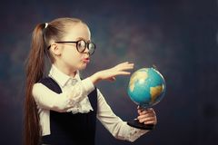 Caucasian Schoolgirl Wear Glasses Turn World Globe. Color Tone stock images