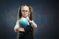 Caucasian Schoolgirl Wear Glasses Turn World Globe royalty free stock photography