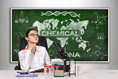 Caucasian scientific researcher woman. Sitting in laboratory and thinking Stock Photos
