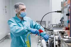 Scientist configure machine with shafts Stock Images