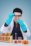 Caucasian scientist doing chemical experiment Stock Photo