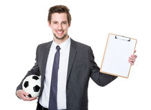 Caucasian scooer manager holding with football and showing with Royalty Free Stock Image