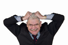 Caucasian senior manager freaking out. A senior caucasian manager freaking out and tearing his hair, isolated on white background Stock Images