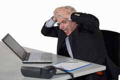 Caucasian senior manager freaking out. A caucasian senior manager  freaking out and tearing his hair, isolated on white background Stock Photo