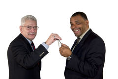 A caucasian senior manager handing over a key Royalty Free Stock Photography